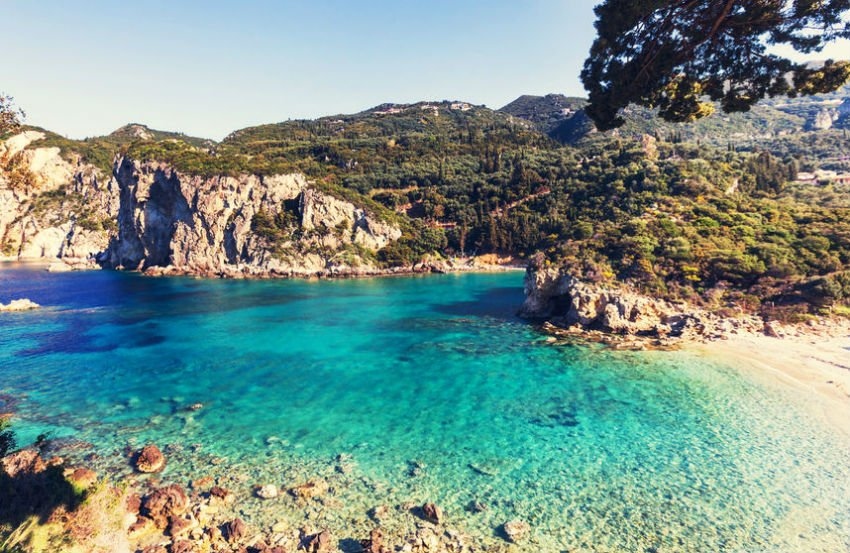 Corfu In Greece Is A Lush Mountainous Island Filled With Cypress Trees Olive Groves And Wondrous Beaches Learn About Ancient Mythology Soak The